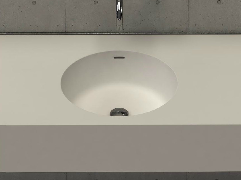 Round wall-mounted washbasin with integrated countertop CIRCLE DESK by DIMASI BATHROOM