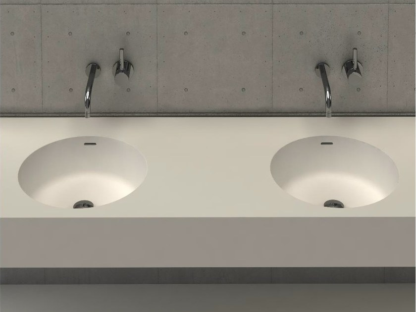Round wall-mounted washbasin with integrated countertop CIRCLE DESK D by DIMASI BATHROOM