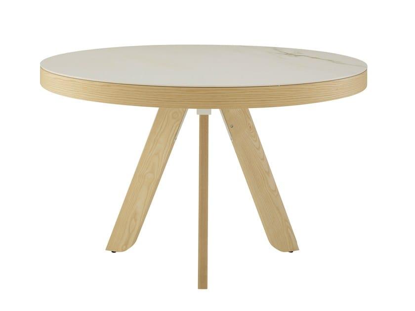 Extending table SATORI by Ligne Roset