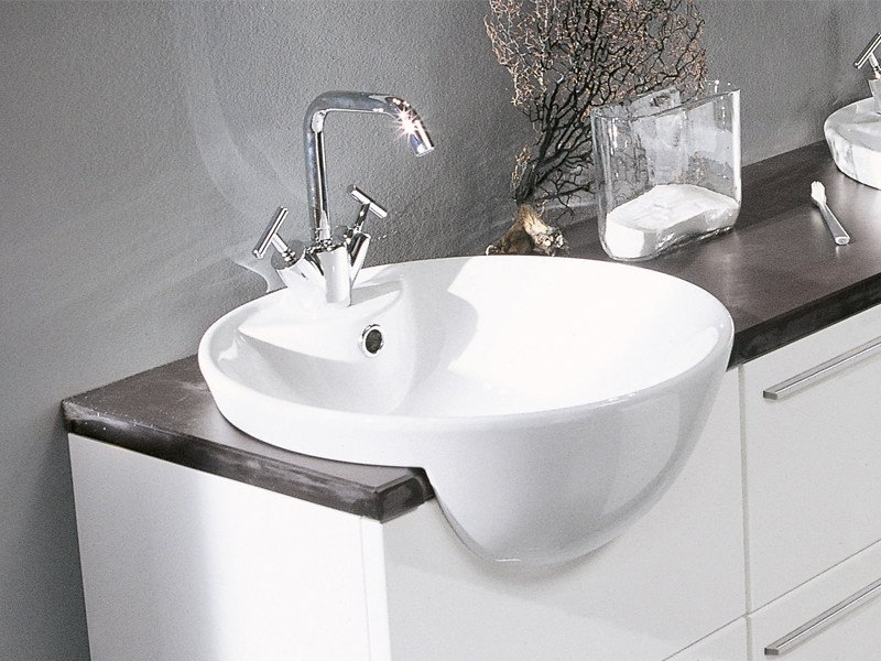Semi-inset oval ceramic washbasin GHOST - Edoné by Agorà Group
