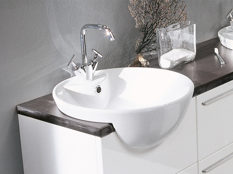 Semi-inset oval ceramic washbasin GHOST - Edoné by Agorà Group