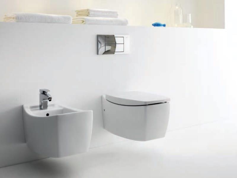 wc suspendu en porcelaine collection tiber by roca design carlo urbinati. Black Bedroom Furniture Sets. Home Design Ideas