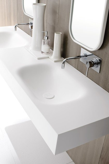 Double Corian® washbasin countertop MOODE | Washbasin countertop by Rexa Design
