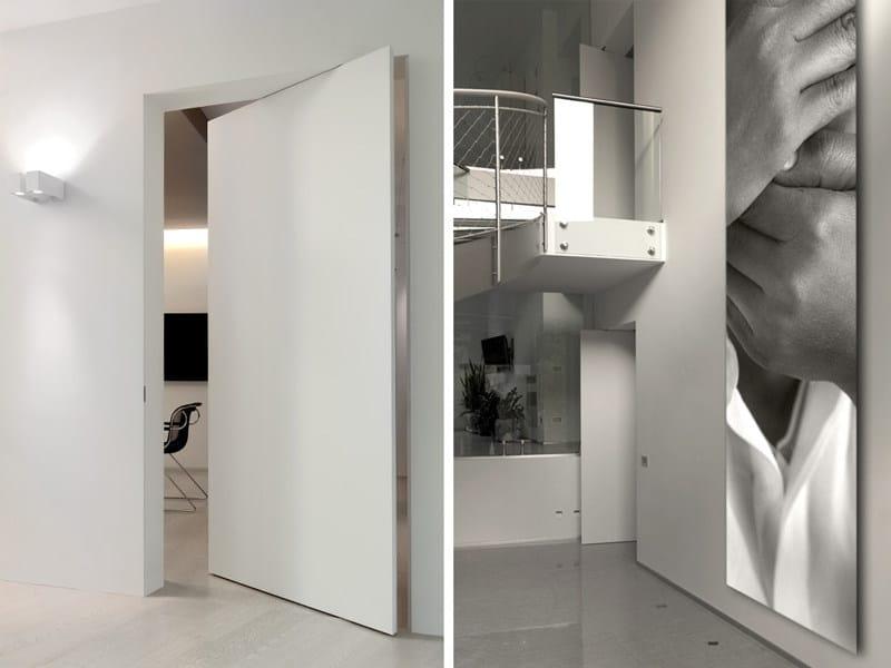 Porta a bilico a filo muro porta a bilico verticale linvisibile - Finestre a bilico verticale ...