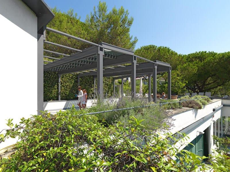 Veranda fotovoltaica in acciaio inox veranda con vetri for Piani di veranda anteriore