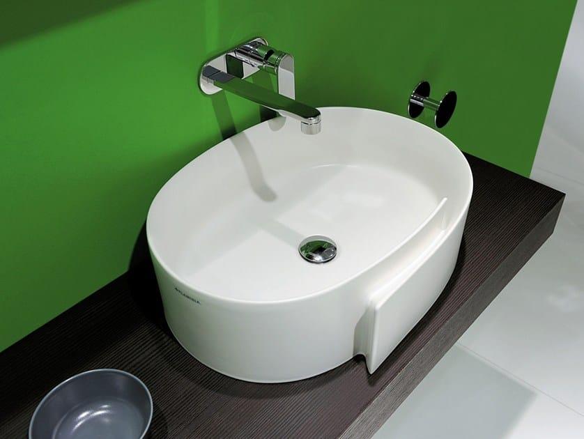 Countertop oval ceramic washbasin ROLL 56 | Countertop washbasin - CERAMICA FLAMINIA
