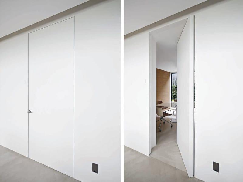 Parete mobile porta porta a bilico verticale filo 10 - L invisibile porte ...