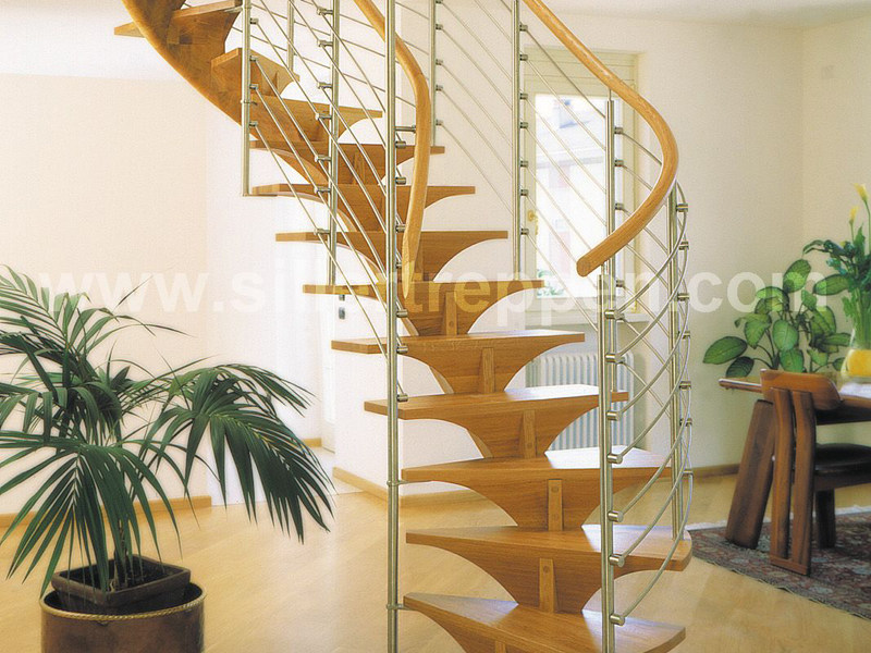 Wooden Spiral staircase PENTAGON by Siller Treppen