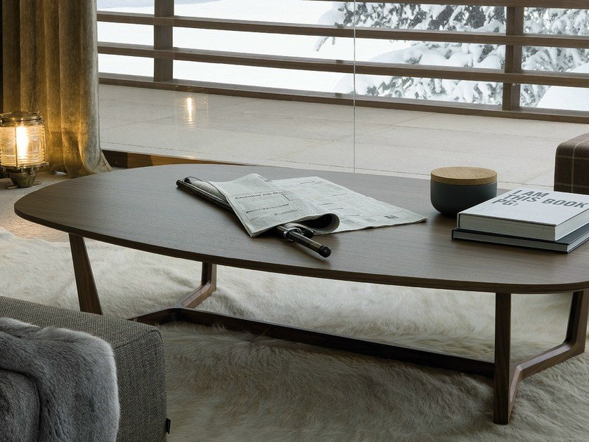 Low oval wooden coffee table for living room