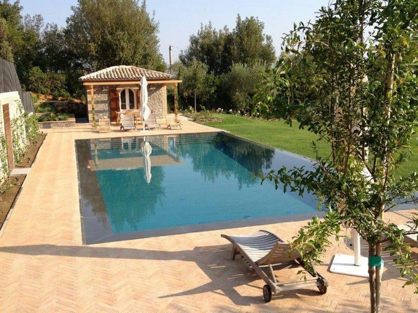 Piscina a sfioro con cascata piscina a sfioro indalo piscine for Piscina con cascata