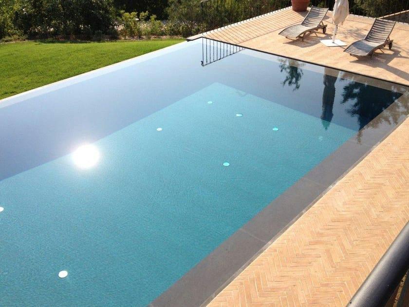 piscina a sfioro con cascata piscina a sfioro indalo piscine. Black Bedroom Furniture Sets. Home Design Ideas
