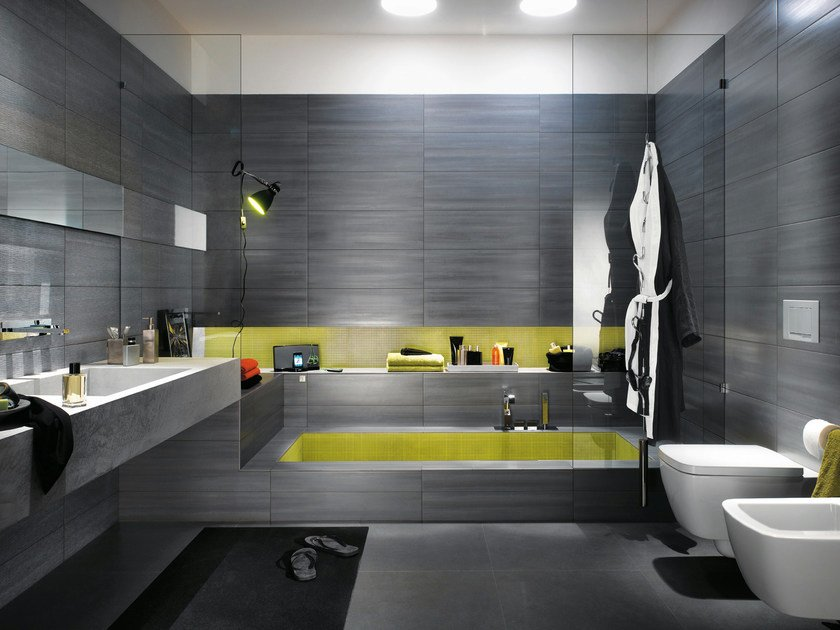 In the photo: bathroom wall tiling from the Zero collection of white body tiles by Fap ceramiche, 25x75 cm in the colour Ardesia, Zero Net 25x75 cm in the colour Ardesia and Zero Micromosaico 30.5x30.5 cm in the colour Giallo.