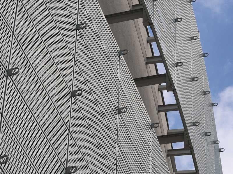 Titanium-Zinc Perforated and embossed sheet for facade Perforated and embossed sheet for facade by RHEINZINK Italia