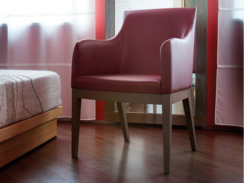 Upholstered wooden armchair with armrests