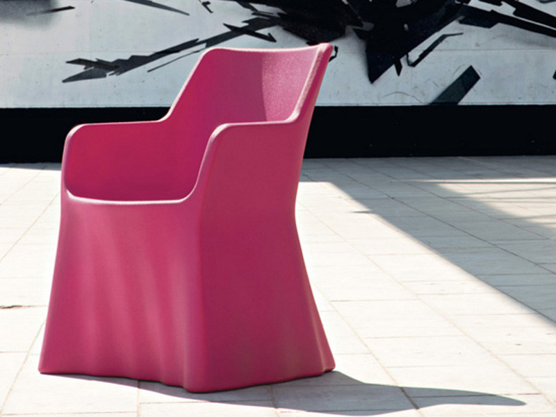 Plastic armchair with armrests