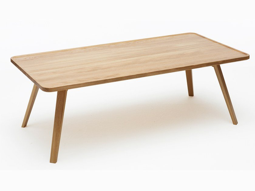 Low rectangular solid wood coffee table