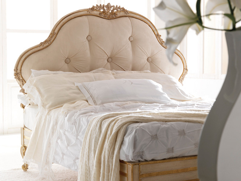 Bed with upholstered headboard