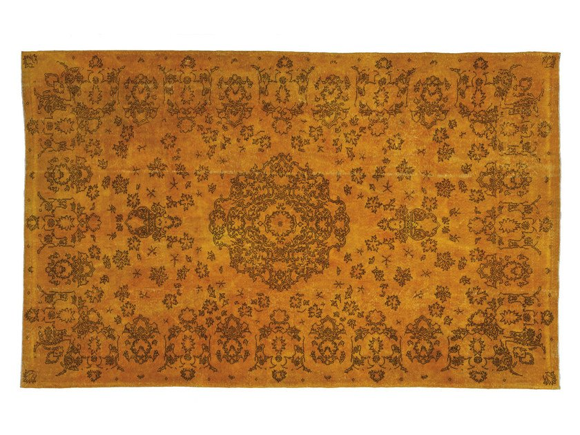 Handmade rug with floral pattern