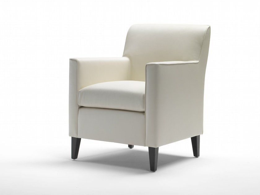 Upholstered leather armchair with armrests