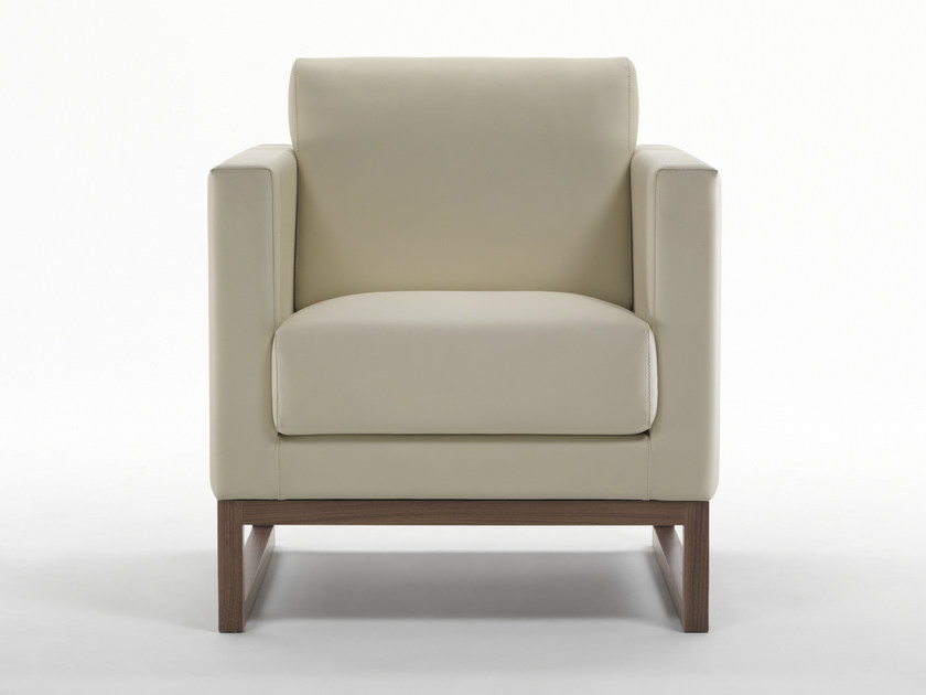 Sled base upholstered leather armchair with armrests