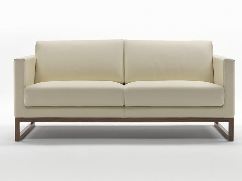 Sled base upholstered leather sofa