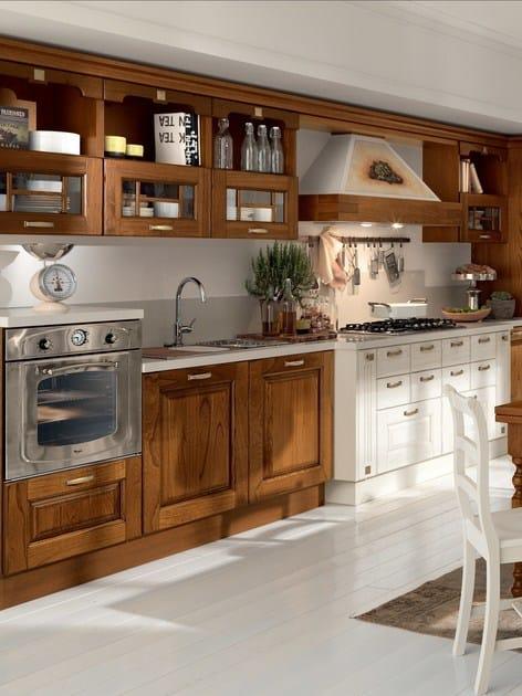 Cucina in legno con maniglie laura cucina in legno cucine lube - Pulire mobili legno cucina ...