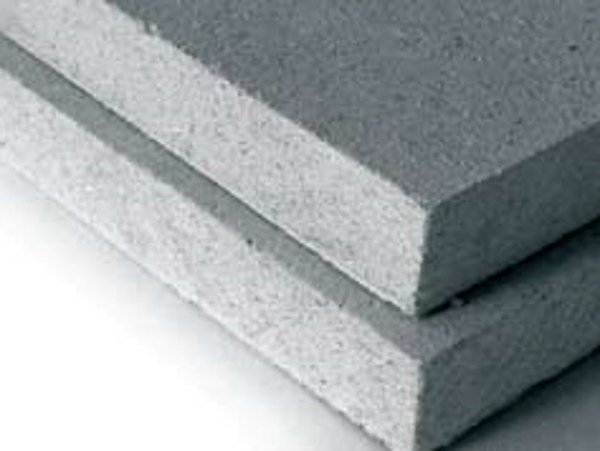 Dry-laid cement and fibre cement sheet