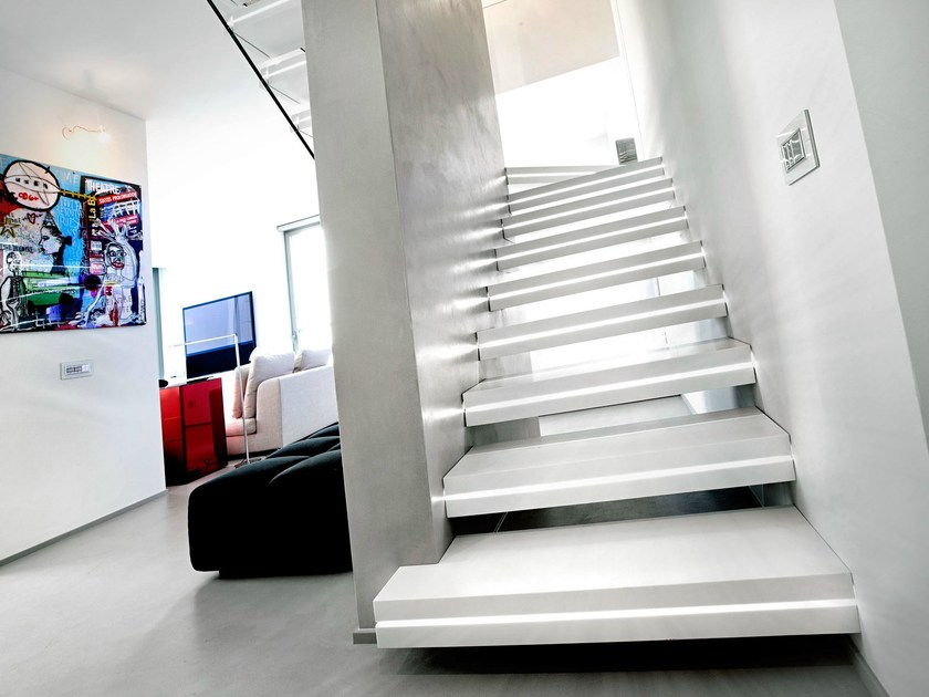 Corian® hanging stairs LUXO SURFACES - OFFICINE SANDRINI