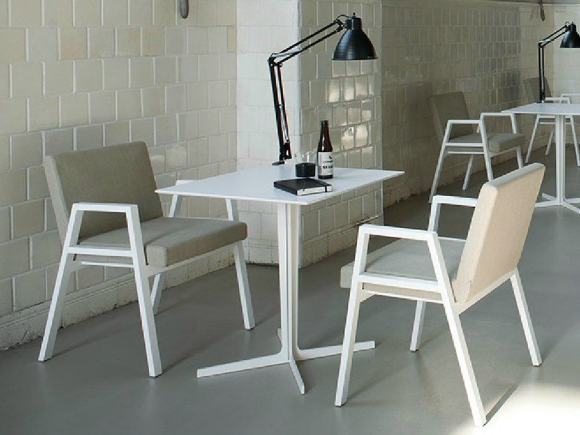 Upholstered stackable chair with armrests BABELA by Tacchini