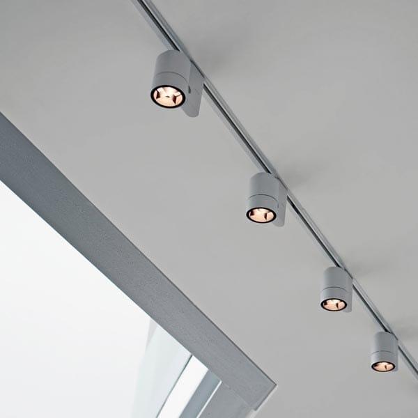 Illuminazione a binario alogena in tecnopolimero PURE SPOT  Illuminazione a binario - FLOS