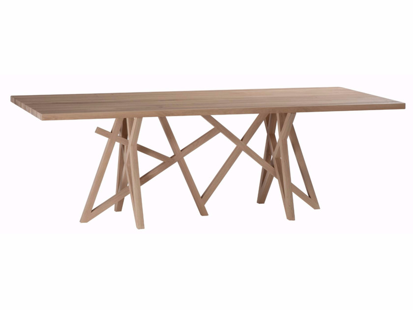 Saga table collection saga by roche bobois design for Table de salle a manger roche bobois