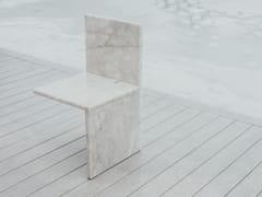 Sedia in pietraAND HERE I SIT - CLASTE