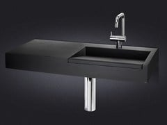 - Wall-mounted resin washbasin with integrated countertop CINCO EXTENDED - Vallvé Bathroom Boutique