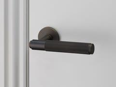 - Industrial style door handle on rose Door Level Handle - Smoked Bronze - Buster + Punch