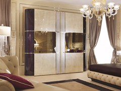 Armadio in legno con ante scorrevoli per hotel con specchioCOUTURE | Armadio - TURRI