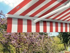 - Motorized fabric Folding arm awning MONACO - Arquati Service