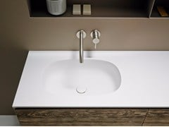 - Corian® washbasin countertop OVALO - INBANI