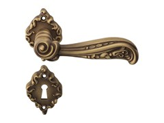 - Chromed brass door handle on rose with lock NATURE | Door handle on rose - LINEA CALI'