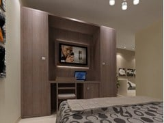 - Melamine-faced chipboard wardrobe with built-in TV for hotel rooms ZEUS | Wardrobe with built-in TV - MOBILSPAZIO Contract