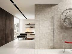 - Porta a bilico a filo muro in cemento FILOMURO | Porta in cemento - GAROFOLI