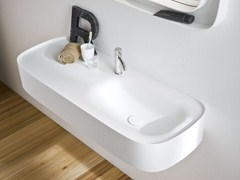 - Wall-mounted Corian® washbasin with integrated countertop FONTE | Washbasin with integrated countertop - Rexa Design