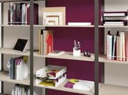 Focus on ARNAGE  shelving as a space divider combined  with ADDENDA acoustic panels