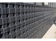 Earth retaining wall drainange and protection system DEFENDER - GEOPLAST