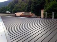 Sistema di copertura metallica a giunto drenante