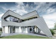 Nuova costruzione Facciata in Scandole PREFA grigio chiaro P.10