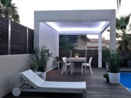 Wall-mounted motorized aluminium pergola with adjustable louvers PERGOLA BIOCLIMATICA | Wall-mounted pergola - INDÚSTRIAS DURMI