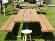 Iroko picnic table with integrated benches CASSECROUTE IROKO - CASSECROUTE