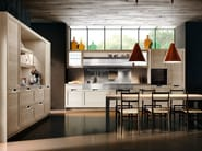 Lux with framed door in Barrique Oak and workstation in st. Steel with integrated cooking and washing.