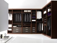 Atlante walk-in closet in dark walnut with details covered with regenerated hard leather