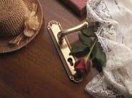 Chromed brass door handle on back plate SISSI | Door handle on back plate - LINEA CALI'